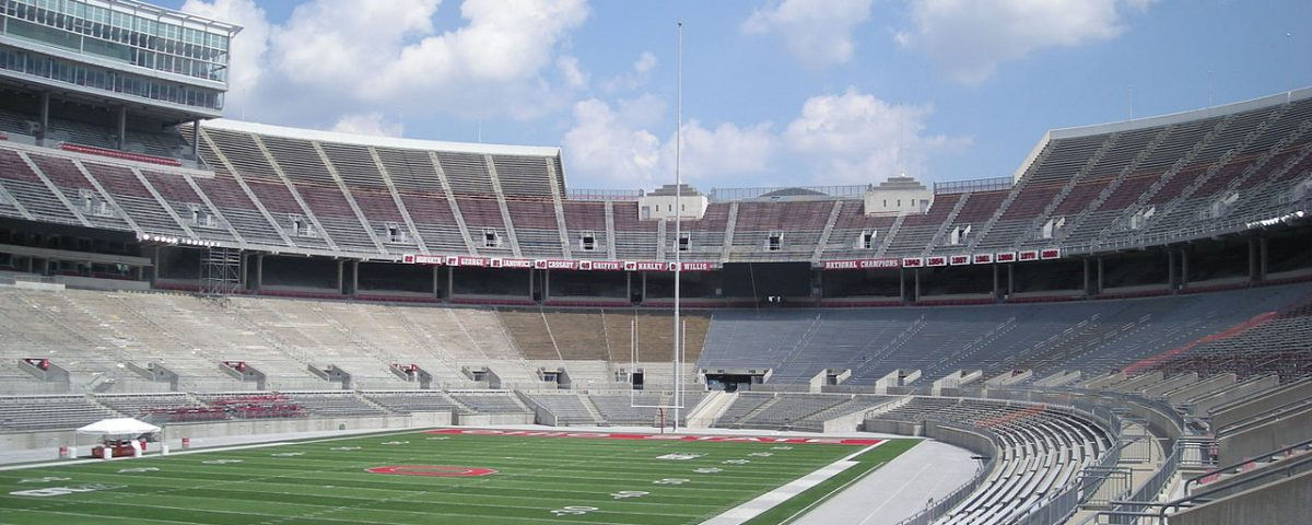 Ohio State University Stadium, the football stadium is empty except for a few people on the field.