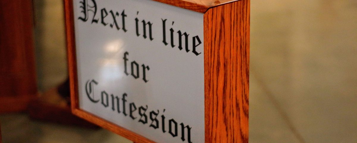 """A sign that states, """"Next in life for Confession."""""""