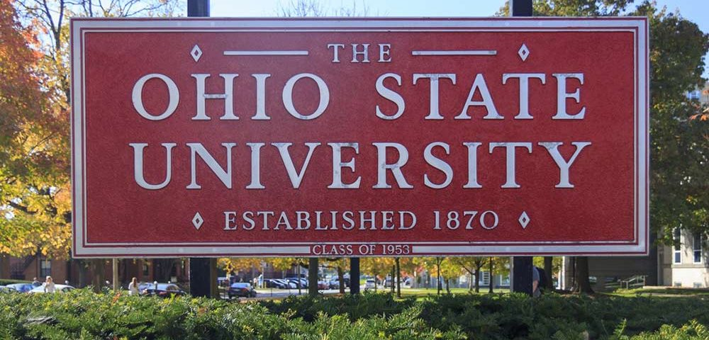 """A large rectangular red sign that reads """"THE OHIO STATE UNIVERSITY, ESTABLISHED 1870, CLASS OF 1953."""""""